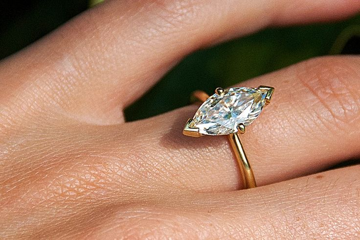 Custom classic and minimal engagement ring  designed for a stunning Marquise diamond by Rosemary Mifsud.