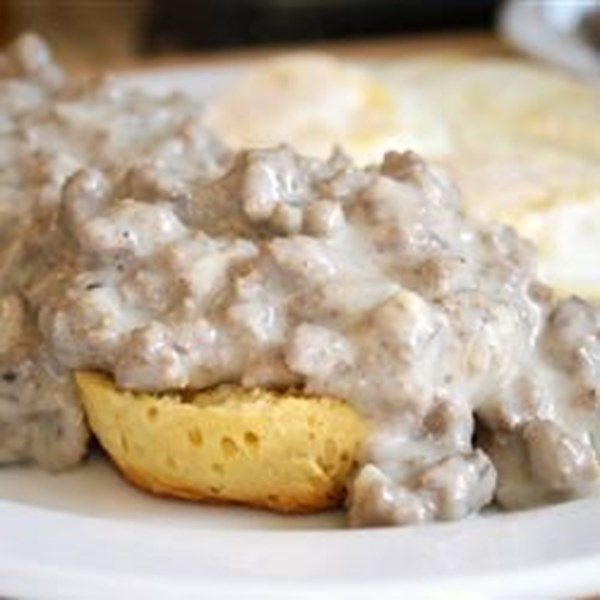 "Dad's Hamburger Gravy | ""This is one of my favorite 'cheap meal' recipes that I learned from my Southern cookin' Dad. Creamy hamburger gravy with just the right blend of spices is perfect served over homemade biscuits, mashed potatoes, rice, fried potatoes.. just about anything!"""