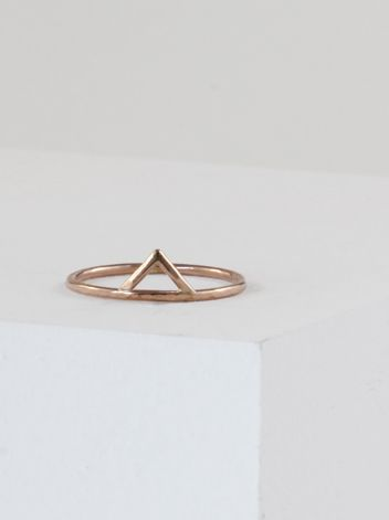 Stefanie Sheehan's single spike ring is made from thin 14K rose gold. The filled and hammered spike ring is handmade in NYC.