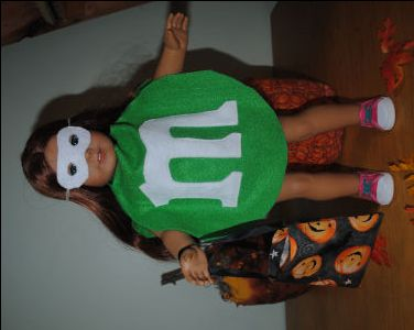 Directions for this cute m&m Halloween costume for your American girl doll also include the mask and trick-or-treat bag. No need for patterns; a quarter and a luncheon plate are to be used as patterns to make this m&m costume!
