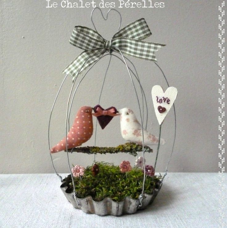 DIY Birdcage made from a vintage pie pan, wire, moss, twig, ribbon, crochet flowers, hearts and fabric love birds. From Le Chalet des Pérelles 8/6/12.