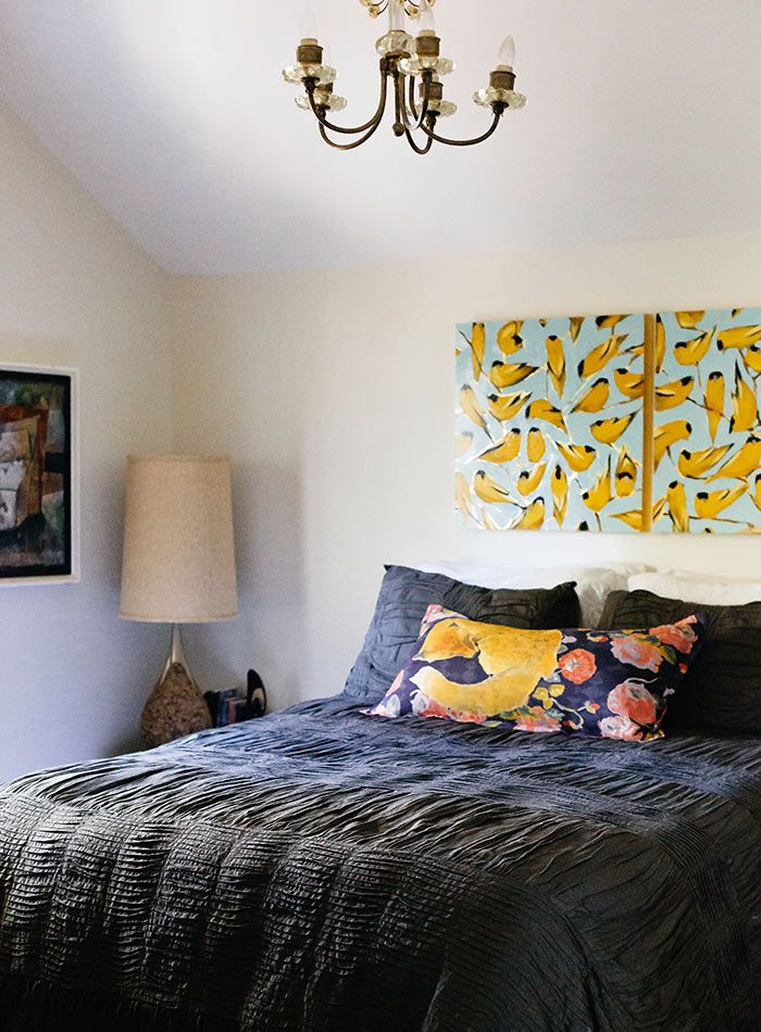 A Chef and Painter's Art-Filled Cottage in South Carolina.  Joseph painted the piece above the bed he shares with wife Rachel, and their duvet is from Anthropologie.