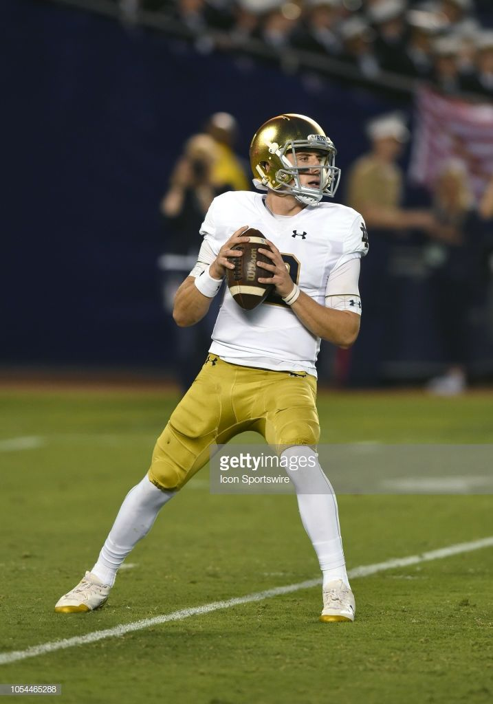 Notre Dame Ian Book Drops Back To Pass During A College Football