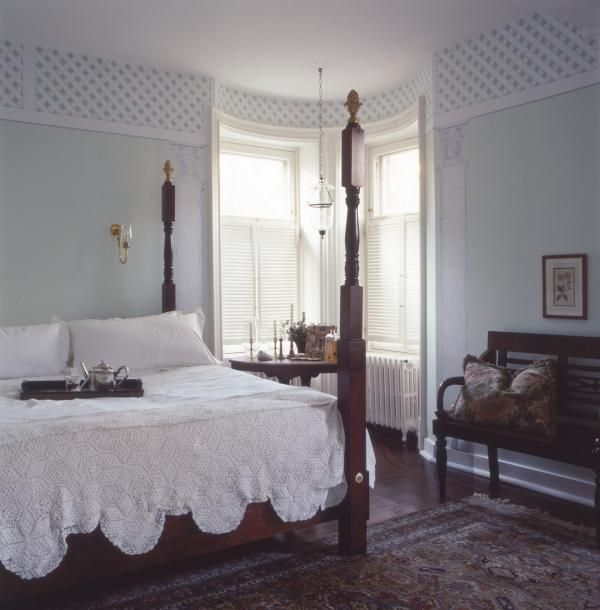 Stencils have been used to create a beautiful border for Plantation style bed
