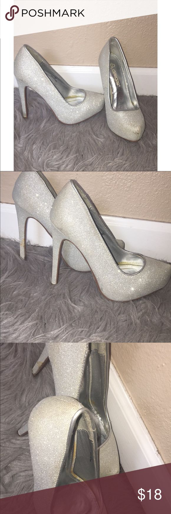 Silver sparkly heels! Wore them once for prom.  Silver sparkly heels! Worn once.  they were stored for a while so the inside has a little bit of yellowing. Perfect for any special occasion. Size 6 1/2 Shoes Heels