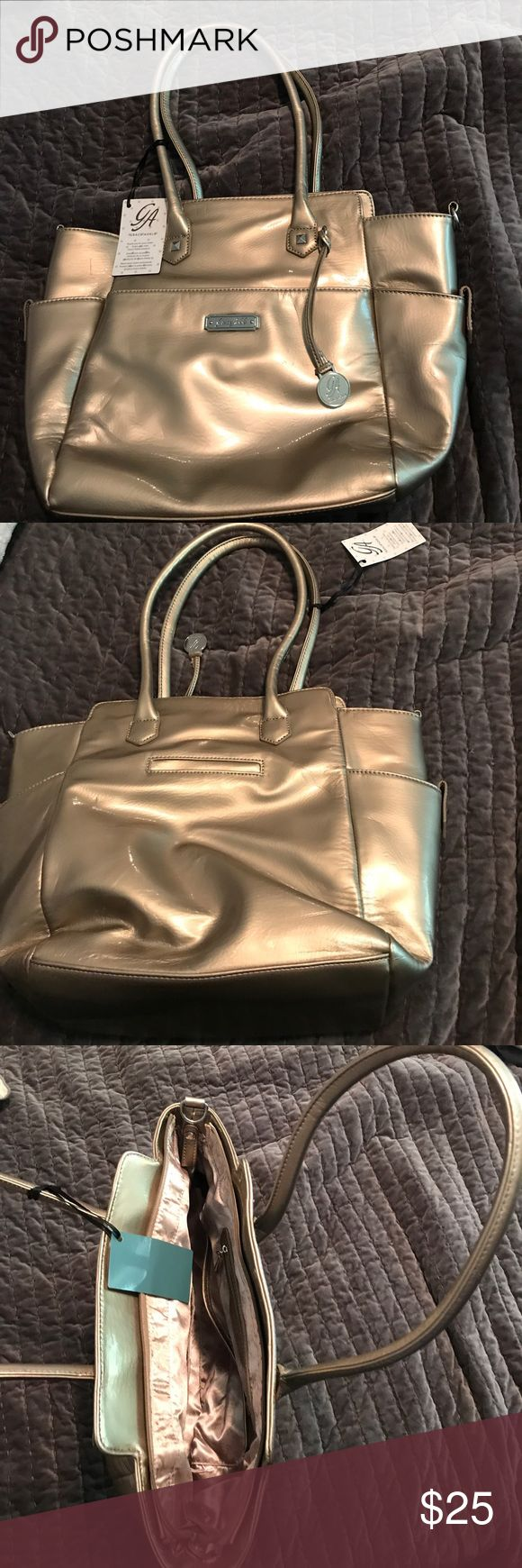 Brand new grace adele bag Brand new with tags. Grace Adele metallic gold large shoulder bag. Never used. Shiny gold interior with many pockets grace adele Bags Shoulder Bags