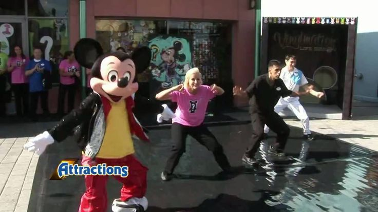 Mickey Mouse shows off his hip-hop dance moves with cast members at the opening of D Street