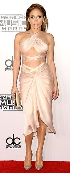 Jennifer Lopez flaunted her tight bod in a blush crisscross dress with an ab-baring design by Reem Acra.