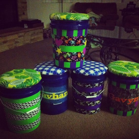 Sit upons for camping.  Made from Lowes painters buckets and decorated with duck tape.  You can put eatery and snacks inside and be able to sit on top around the camp fire.  We went to a Girl Scout meeting tonight and this is what they made for there up coming camping trip. So PERFECT for scouts.
