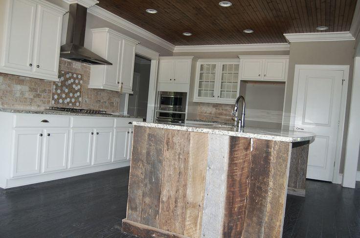 classic kitchen with white cabinets barnwood hexagon backsplash
