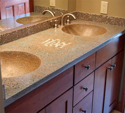 The aggregate in this concrete countertop actually glows in the dark. During the day the design between the sinks has a nice white tint, but at night it turns blue.