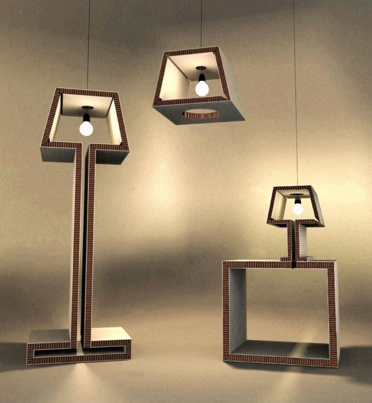 """Re-Lamp by Amaya de Corral. Re-Lamp is an innovative design that decontextualize the traditional lamp. Re-Lamp is a set of three lamps: !oor lamp, table lamp and ceiling lamp.     From a previously handled sheet of Re-Board system of """"do-it-yourself"""" you get a cheap, stable and functional lamp. The qualities of the material make the Re-Lamp objects resistant, """"re retardant and durable. They also provide a warm light with a contemporary cardboard with some cuts and folds and a aesthetic."""