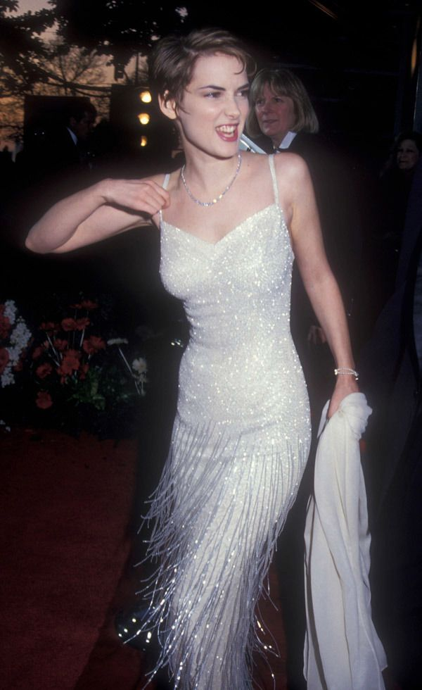 Winona Ryder's 12 Best '90s Outfits - Ryder wore this perfect beaded flapper-style fringed dress to the Academy Awards in 1994. One of next season's biggest trends from New York Fashion Week? Fringe.
