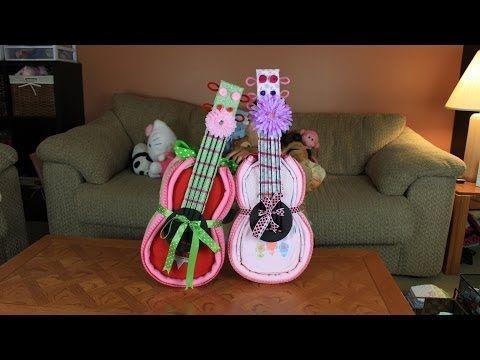 Guitar diaper cake 50 size 1 diapers, 1 bodysuit,1 fleece blanket, 5/8 ribbon, 7/8 ribbon, string, pipe cleaner, foam board, tape, flower head band $65
