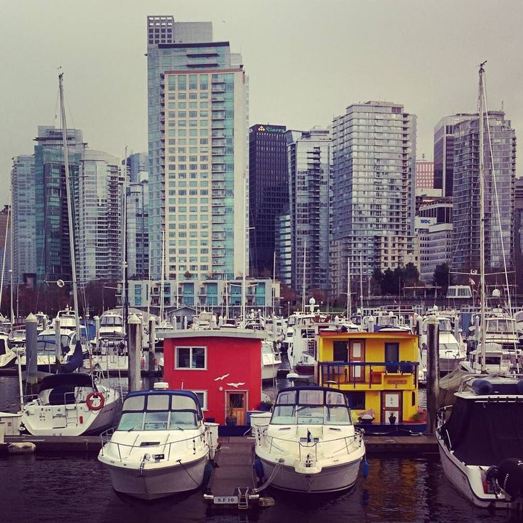 Cheerful float homes in a sea of grey.  #marina #vancouver #seawall #floathome #tinyhouse #houseboat #greyskies #cityscape by oceangato