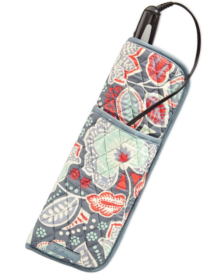 Keep cords plus your curling iron or hair straightener neatly tucked away in Vera Bradley's quilted cover in cheery cotton. A heat-resistant inner lining makes it perfect for travel. | Cotton | Import