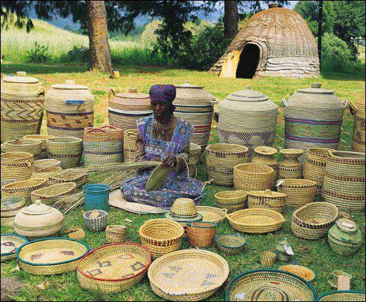 Woman weaving baskets at Cathedral Peak, KwaZulu-Natal
