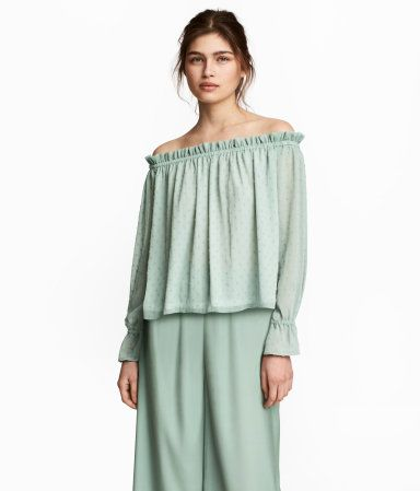 Dusky green. Off-the-shoulder blouse in plumeti chiffon with elasticized trim at top and long sleeves with elasticized, flounced cuffs. Rounded hem. Jersey