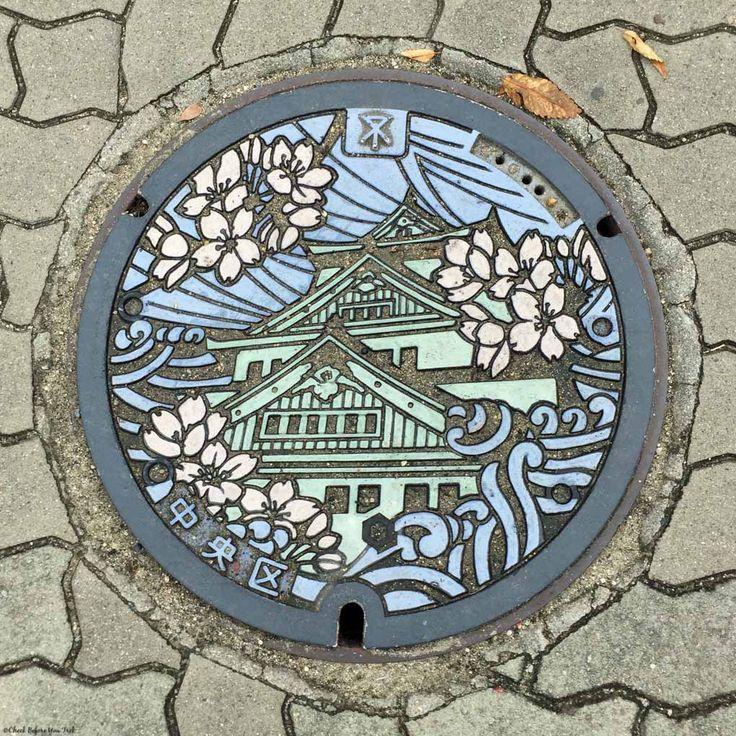 Manhole cover with drawing of Osaka Castle - Osaka, Japan