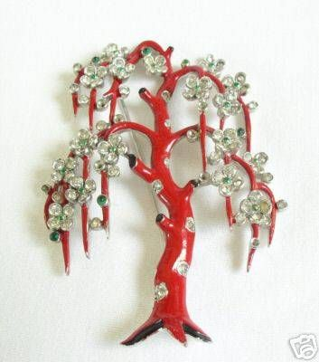 Trifari Weeping Willow BroochCirca: Early 1940s  This is an extremely rare Trifari piece that came in several different colorations, including goldtone with no enameling