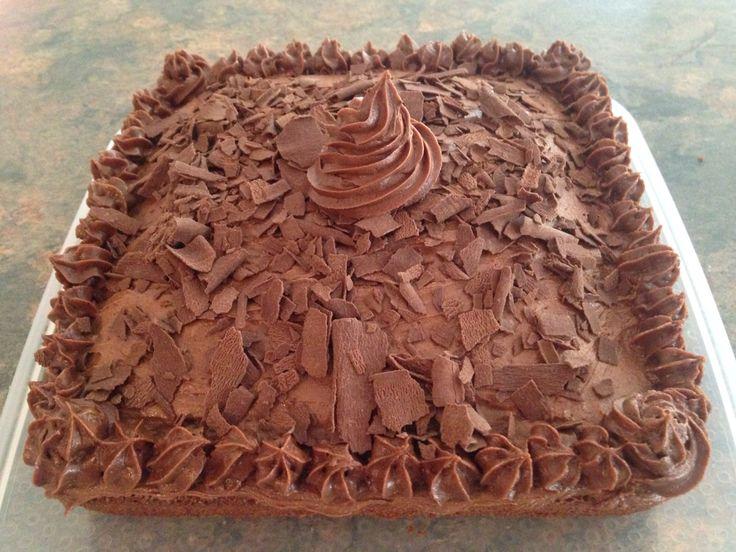 chocolate cake with chocolate buttercream and Cadbury Flake sprinkles on top!