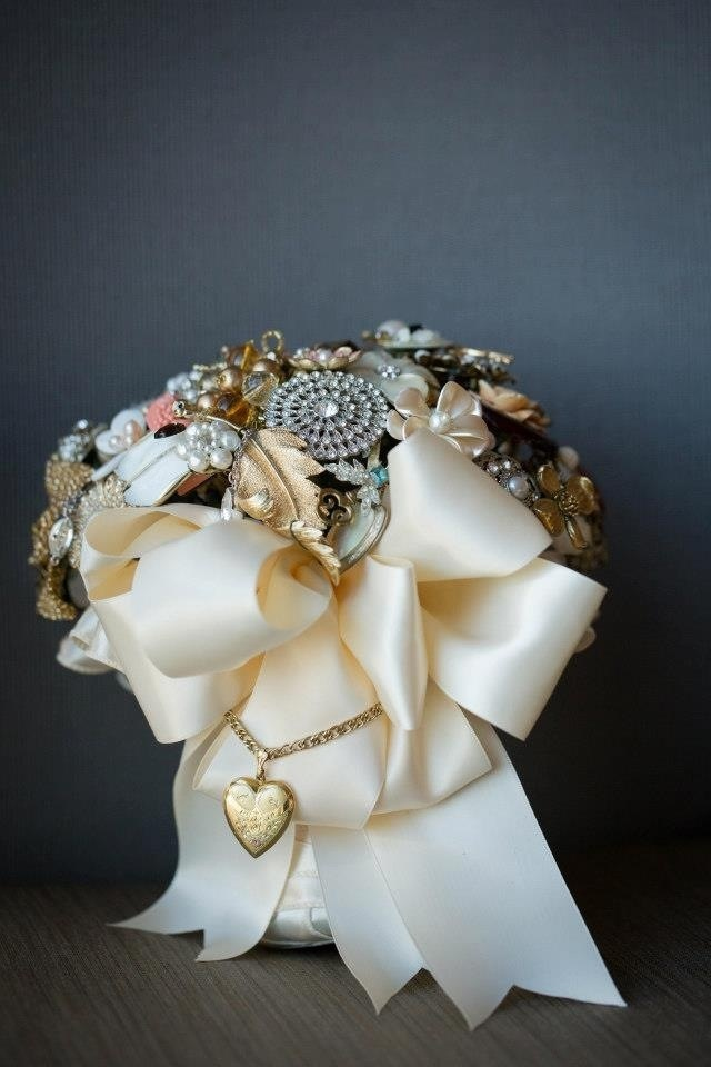 Brooch bouquet by Brooch Bridal Bouquets - made with jewelry & brooches from family & friends. Photo by Annie O'Neill Photography