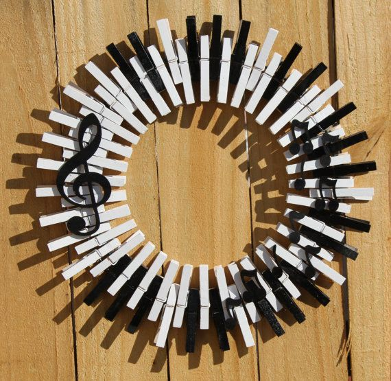 Music Wreath, Piano Keys Wreath, Musical Notes, Treble Clef, Crocheted Wreath, Quarter Note, Music Home Decor  This charming music themed clothespin wreath is sure to impress. Designed to be reminiscent of piano keys and adorned with a treble clef and music notes, this wreath will look great on your front door! Wreath is approximately 16x16. Includes hidden hanging wire.  Looking for something custom? Please let me know! I am happy to work with you to create something unique for your home…