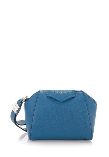 Electric #blue goatskin 'Antigona' #clutch from #Givenchy featuring a trapeze body, a top zip closure, a wrist strap, a front logo plaque, a cotton lining and an internal logo patch. http://bit.ly/1RrP3Ad