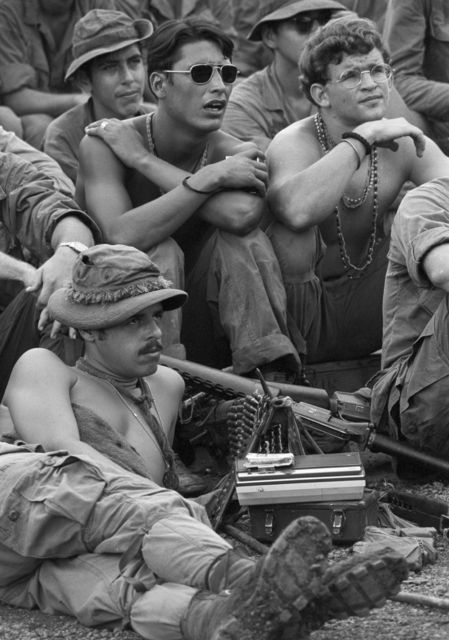 A variety of expressions are on the faces of these First Cavalry Division troops as they watch the Miss America show presented at Firebase Sherman in South Vietnam, Sept. 3, 1971.  The men had just returned from an operation in the field.   / Credit: AP Photo/Rick Merron