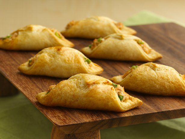 These Asian-inspired appetizers start with flaky crescent roll pastry wrapped around a quick cream cheese and crab filling.