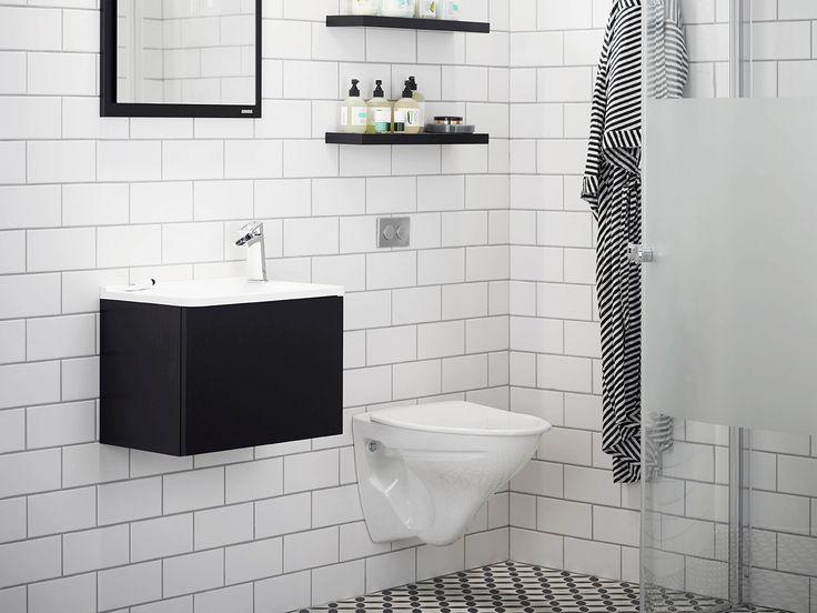 badrum,badrumsrenovering,grafiskt,tvättställ,litet badrum,badrumsskåp