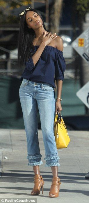 Leggy lady!She teamed the garment with a pair of cut off denim jeans with a frayed hem an...