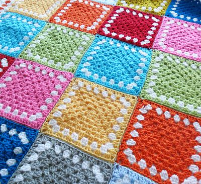teawagontales: a bit of kitsch.........  A gorgeous afghan using the old Granny Square... it's all in the placing of colours in each square that makes all the difference... this one looks so prime n proper, with the 1 row of white... Great job Jane... <3