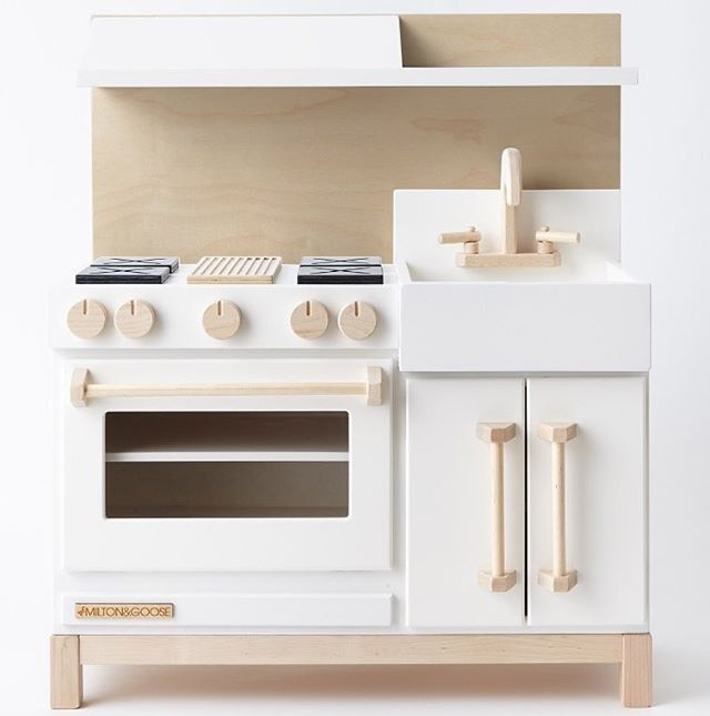 Nontoxic wooden play kitchens made in USA. Neutral colors and designer touches. Chalkboard, farmhouse sink, and extra storage. Toddler and kids toy age 3 & up.