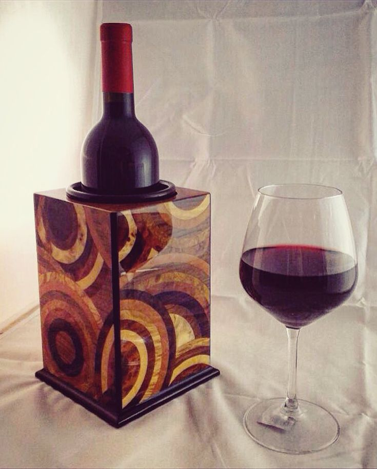 Decor your table with this elegant inlaidwood bottle holder!The decoration are in inlaidwood and inside a handmade ceramic pot easy to wash and to better preserve your favorite wines! Discover our products on www.mgfineinlaid.com and contact us for any informations!  #wine #winelover #winery #canteen #picoftheday #photooftheday #beautiful #amazing #gift #weddinggift #wedding #restaurant #homedecor #hotel #hotellerie #tableware #tabletop #tabledecor #glassofwine #redwine #design #wood #decor…