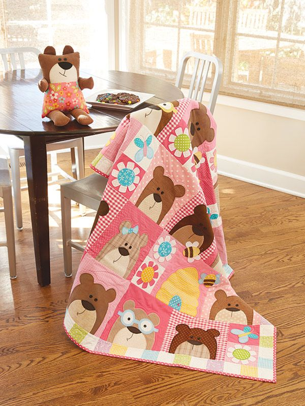 This sweet SNUGGLE BEARS QUILT with matching soft toy is the perfect handmade gift for that special little someone in your life. Find the pattern and nine other matching sets in Happy Quilts by Antonie Alexander.