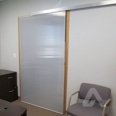 Multiwall polycarbonate barn door style sliding door for Sliding door manufacturers