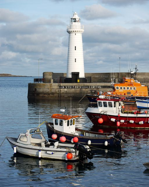 Donaghadee Lighthouse Ireland - boats in harbor with lighthouse in background