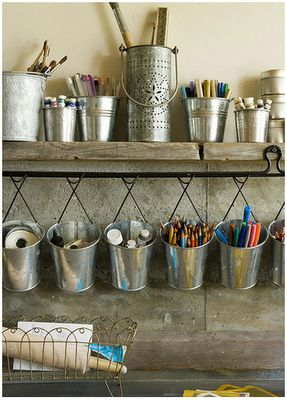 Like the idea of hanging everything off the wall like this.  Could even go cheap and use tin cans covered in cute papers, then use dowel and hooks from Bunnings.