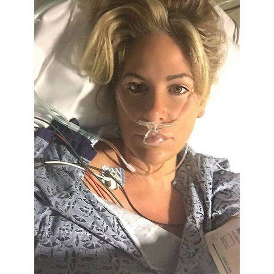 Kim Zolciak remains in hospital for more tests after mini stroke, but prognosis looks good. Tony Dovolani is by her side for support!
