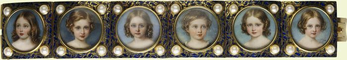 Queen Victoria's liking for miniature portraits was served particularly well by this bracelet which was commissioned by Prince Albert. Presented on her twenty-sixth birthday in 1845, with the miniature of her eldest child, Victoria, the bracelet was subsequently added to with portraits of five further royal children as they reached the age of four.