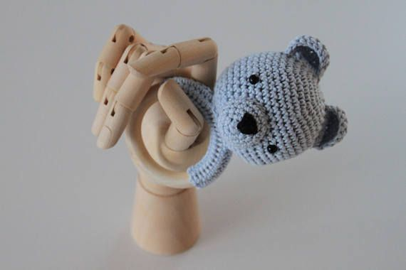 Sambo is a handmade, cotton amigurumi teething ring and rattle. The ring is in 100 % wood and has a diameter of 7 cm. The rattle makes a subtle sound to get your babys attention.