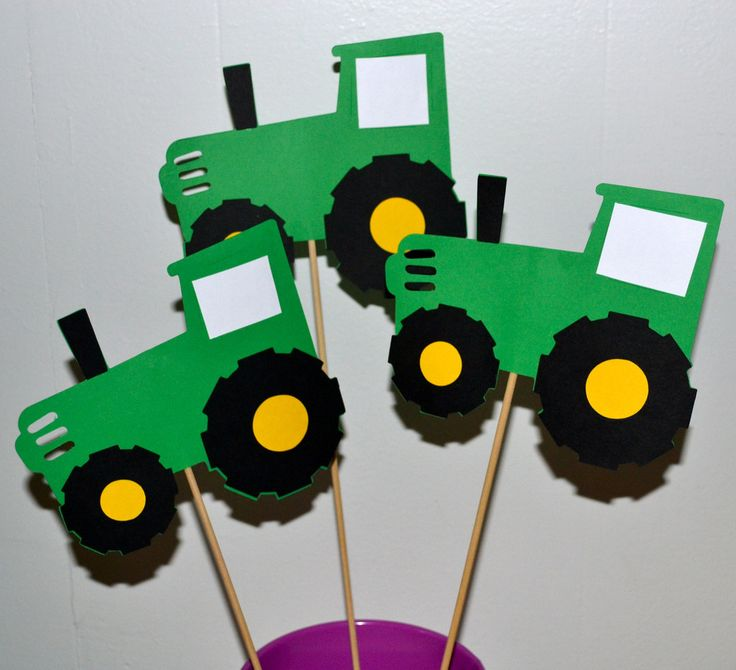 "These John Deere inspired greed tractors table toppers would be a great addition to any boy or girl's party or a baby shower. You will receive 3 tractors. These toppers measure around 6"" and are on 12"