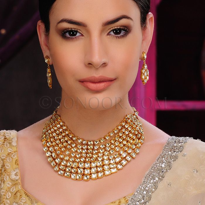 NEC/1/3445 Ishya Necklace Set with Earrings in dull gold finish studded with kundan stones  $438