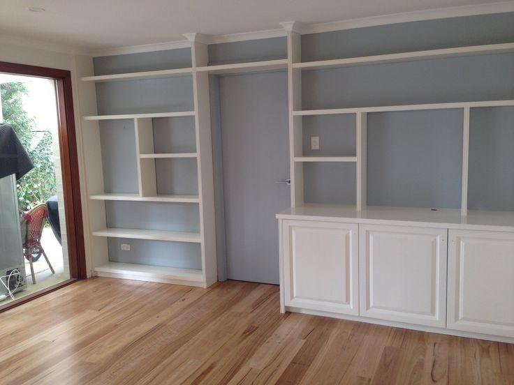 Resene Pereglacial blue bookcase, matt blacbutt floors, resene buttery white walls