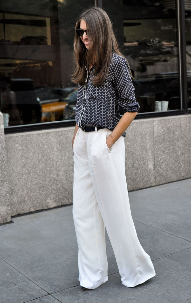 Slouchy pajama print top paired with flared white trousers. #casual #chic #streetstyle