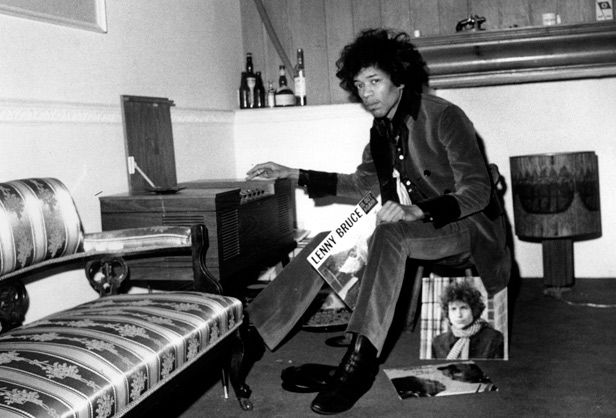Jimi Hendrix at home in 1967 with his record collection. Note the Lenny Bruce and Bob Dylan albums.