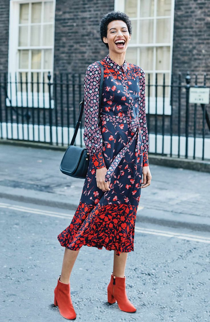 A boho mix of sweet floral prints enlivens a woven shirtdress in a demure A-line cut wrapped with a sash.