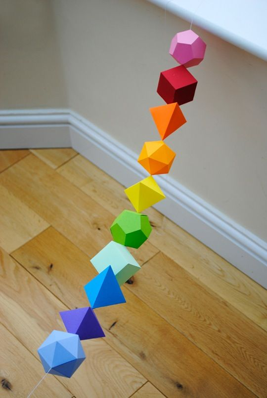 A fun paper craft, a painless lesson in symmetry and mathematics, an easy way to introduce a pop of color, and an excuse to say the word dodecahedron. What's not to love about this DIY garland comprised of Platonic solids.