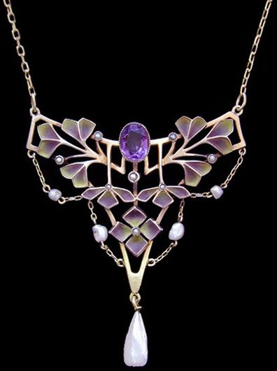 This is not contemporary - image from a gallery of vintage and/or antique objects. LEVINGER & BISSINGER  An impressive gilded silver plique-a-jour pendant with graduated colours set with  a central amethyst and pearls with pearl drops.